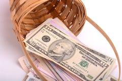 Europeiska pengar på träkorgen, hryvnia, dollar, euro Fotografering för Bildbyråer