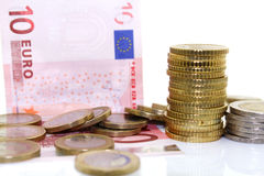 Europejczyków rachunki na białym tle i monety Zdjęcie Stock