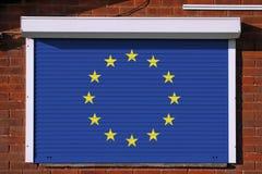 Europejczyk flaga na zamkniętych ochron żaluzjach obraz royalty free