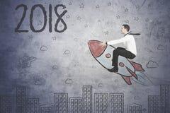 Europejski biznesmena latanie w kierunku liczb 2018 Obraz Stock