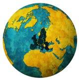 Europejski zrzeszeniowy terytorium z flaga nad kuli ziemskiej mapą Fotografia Royalty Free