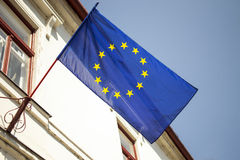 Europena Union flag. Blue with yellow stars european union flag hanging from building Royalty Free Stock Photography
