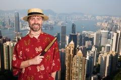 Europese mens in traditioneel Chinees kostuum in Hong Kong royalty-vrije stock afbeeldingen