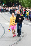 Europride 2014 Couple looking to each other on parade Stock Image