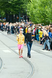 Europride 2014 Couple on parade with flags in hand Royalty Free Stock Image