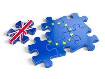Europuzzlespiel und ein Puzzlespiel-Stück mit Großbritannien-Flagge Lizenzfreie Stockfotos