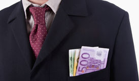 Euros. Businessman with tie showing Euro bills on the pocket, isolated in white Stock Photos