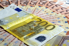 Euros 200 and 50. THESSALONIKI, GREECE - AUG 23: Euro banknotes as a background, close-up on August 23, 2012 in Thessaloniki,Greece Royalty Free Stock Photography