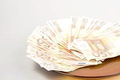 Euros. Many Euros on the plate Royalty Free Stock Photos