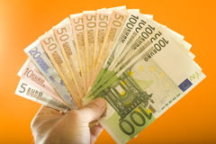 Euros. A lot of euros in one hand Royalty Free Stock Photo