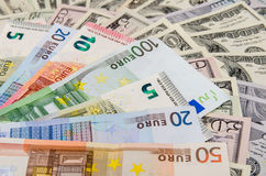 Euros above dollars Stock Photos