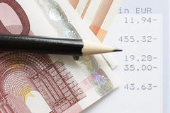 Euros and account statements. Cash and audit stock photo