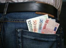 Euros in back pocket Stock Photos