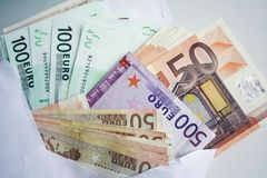 Euro bank notes background. Close up view of some euro bills going out of an envelope Royalty Free Stock Images