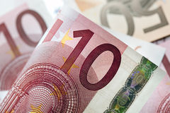 Euros Background. Euro notes in full-frame, with focus on front ten Euro note Royalty Free Stock Photos