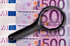 500 euros banknotes and magnifying glass Royalty Free Stock Photos