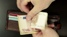 180 euros from billfold. Man hands are taking out 180 euros of billfold stock video footage