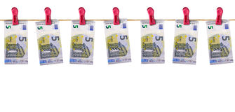 Euros bills hanging from a line. Royalty Free Stock Photography