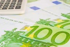 Euros and calculator Royalty Free Stock Photos