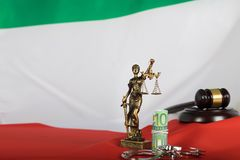 Euros close to the statue of Themis. Italian flag in the background royalty free stock image