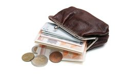 Euros and coins in pouch royalty free stock photography