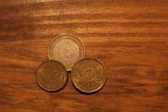 Euros coins. 3 Euros coins on a wood table Stock Photos
