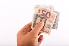 Euros da posse da mão Fotografia de Stock