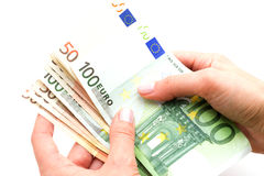 Euros dans les mains sur le fond blanc Photographie stock libre de droits