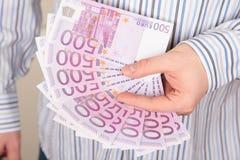 Euros dans une main Image libre de droits