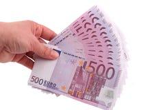 Euros de la explotación agrícola de la mano foto de archivo libre de regalías