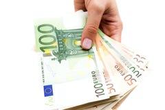 Euros in den Händen auf weißem Hintergrund Lizenzfreies Stockbild