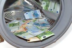 Euros dentro de la lavadora, concepto del blanqueo de dinero imágenes de archivo libres de regalías