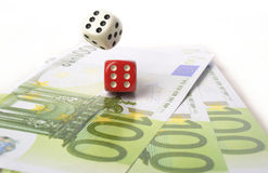 Euros and dice Stock Photography