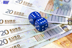 Euros and dice Royalty Free Stock Images