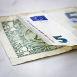 Euros and dollars Stock Image