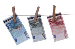 Euros drying on line Stock Photography