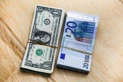 Euros e dólares na tabela Fotos de Stock Royalty Free
