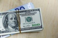 Euros e dólares na tabela Imagens de Stock Royalty Free