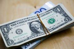 Euros e dólares na tabela Fotografia de Stock