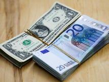 Euros e dólares na tabela Imagem de Stock Royalty Free