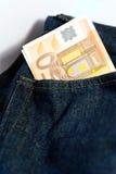 Euros en bolsillo Imágenes de archivo libres de regalías
