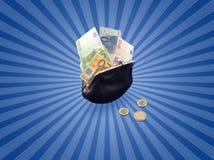 Euros en monedero negro Imagenes de archivo