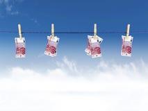 Euros en una cuerda para tender la ropa Imagen de archivo libre de regalías