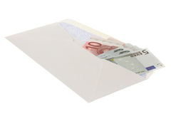 Euros in Envelope. A stock photo of some Euros in an envelope set against a white background Royalty Free Stock Photos