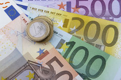 Euros (EUR) coins and notes. 50, 100, 200 and 500 Euro notes. 1 Euro coin on the left Stock Photos