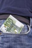 Euros (EUR) in einer Tasche Stockbild