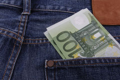 Euros (EUR) in a pocket. Of a pair of blue jeans Stock Photography