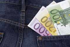 Euros (EUR) in a pocket. Euros (EUR) in a pocket of a pair of blue jeans. (100 Euro, 200 Euro and a 500 Euro note Royalty Free Stock Photos