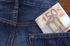 Euros (EUR) in a pocket. Euros (EUR) in a pocket of a pair of blue jeans. (50 Euro note Stock Photo