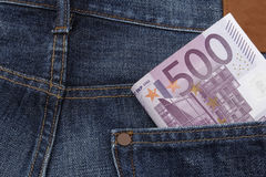 Euros (EUR) in a pocket. Euros (EUR) in a pocket of a pair of  jeans. (500 Euro note Stock Images